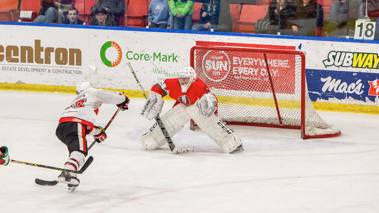 December 31, 2016 - Mac's Midget Tournament, Max Bell Centre, Calgary, Alberta - Male Division Semi-Final - Cariboo Cougars vs. Belarus National U17 - Cougars forward #23 Hunter Floris scores a late third period goal which would tie the game at 4-4 taking the game into over-time.