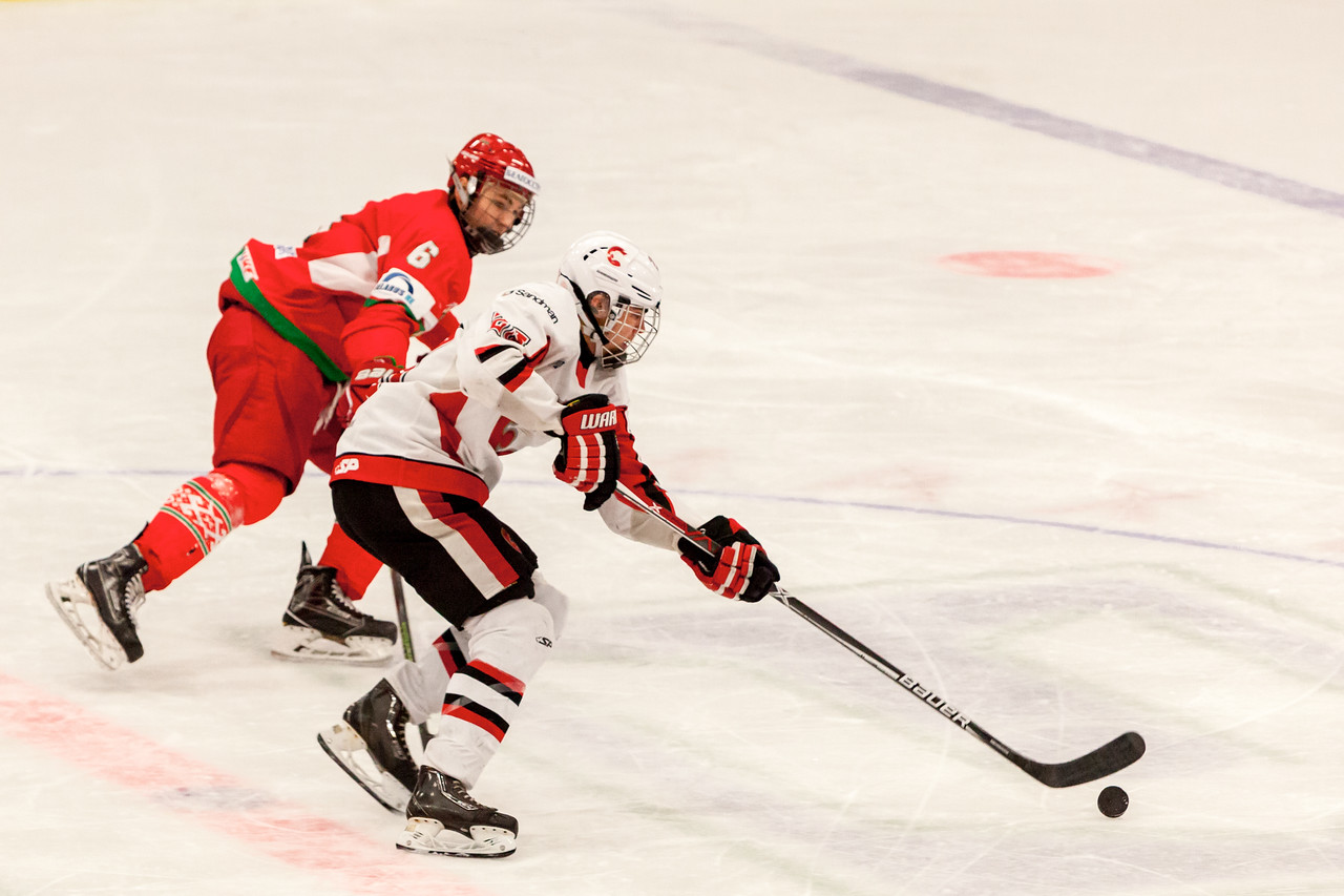 December 31, 2016 - Mac's Midget Tournament, Max Bell Centre, Calgary, Alberta - Male Division Semi-Final - Cariboo Cougars vs. Belarus National U17 - Cougars #25 stick handles the puck past Belarus #6 DMITRI SAVRITSKI.