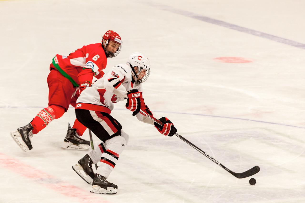 December 31, 2016 - Mac's Midget Tournament, Max Bell Centre, Calgary, Alberta - Male Division Semi-Final - Cariboo Cougars vs. Belarus National U17 - Cougars #25 stick handles the puck past Belarus #6 DMITRI SAVRITSKI.