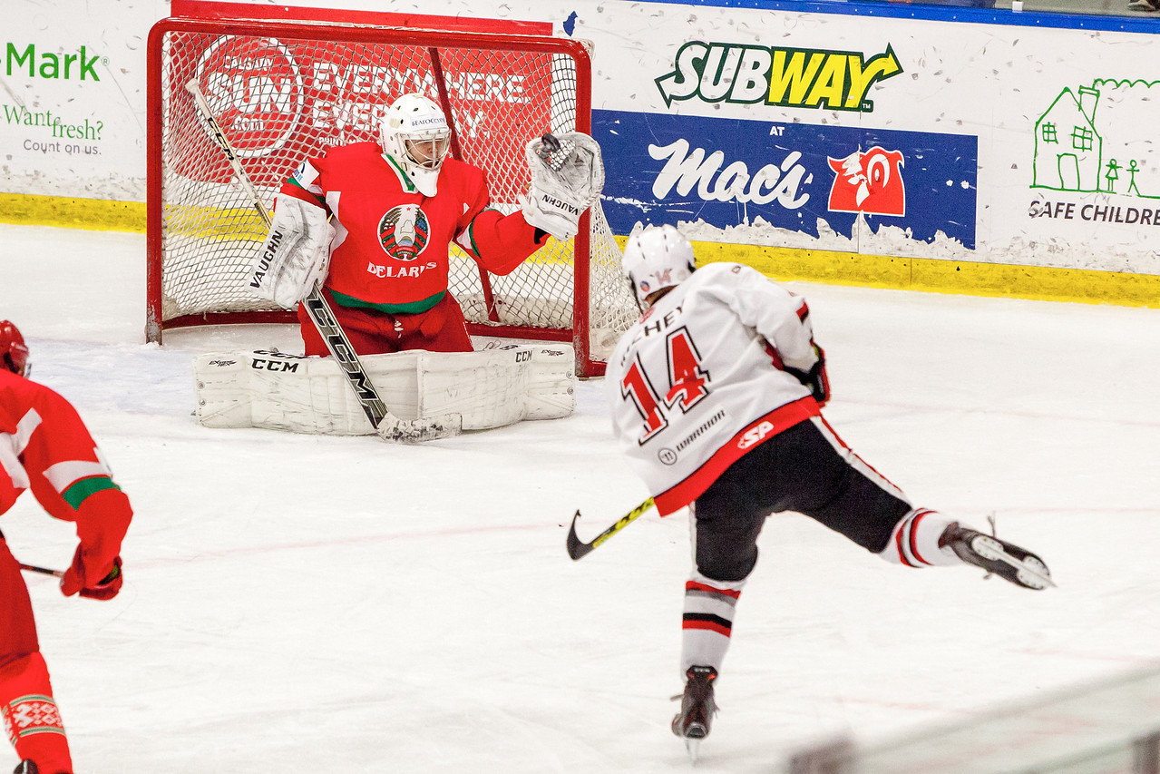 December 31, 2016 - Mac's Midget Tournament, Max Bell Centre, Calgary, Alberta - Male Division Semi-Final - Cariboo Cougars vs. Belarus National U17 - Cougars forward #14 Mason Richey shoots the puck on Belrus Goalie #1 ANDREI GRISHENKO during late third period action.