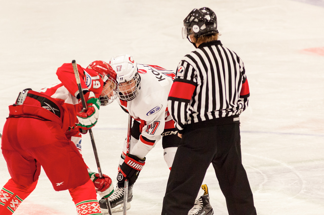 December 31, 2016 - Mac's Midget Tournament, Max Bell Centre, Calgary, Alberta - Male Division Semi-Final - Cariboo Cougars vs. Belarus National U17 - Cougars forward #17 Ty Kolle faces off with Belrus #19 VASILI FILYAYEV.