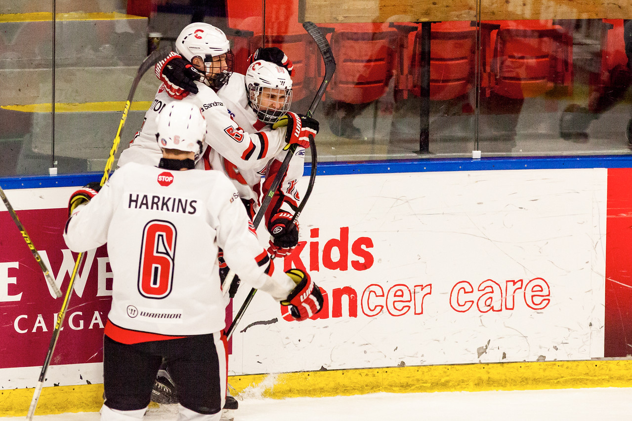 December 31, 2016 - Mac's Midget Tournament, Max Bell Centre, Calgary, Alberta - Male Division Semi-Final - Cariboo Cougars vs. Belarus National U17 - Cougars players #6 Jonas Harkins, #5 Devin Sutton and #18 Trey Thomas celebrate a goal.