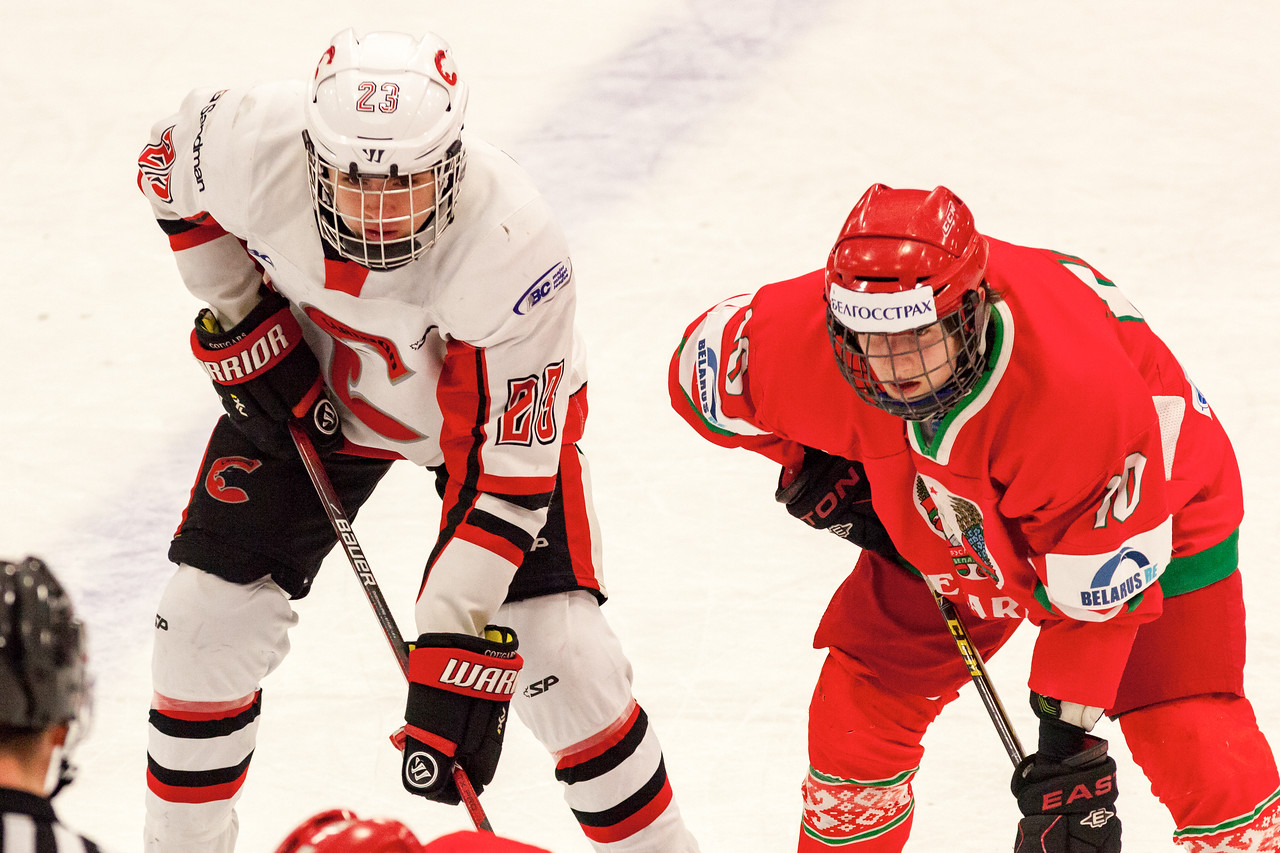 December 31, 2016 - Mac's Midget Tournament, Max Bell Centre, Calgary, Alberta - Male Division Semi-Final - Cariboo Cougars vs. Belarus National U17 - Cougars forward #23 Hunter Floris (white) and Belarus forward #10 KIRILL MEZHEINIKOV (red).