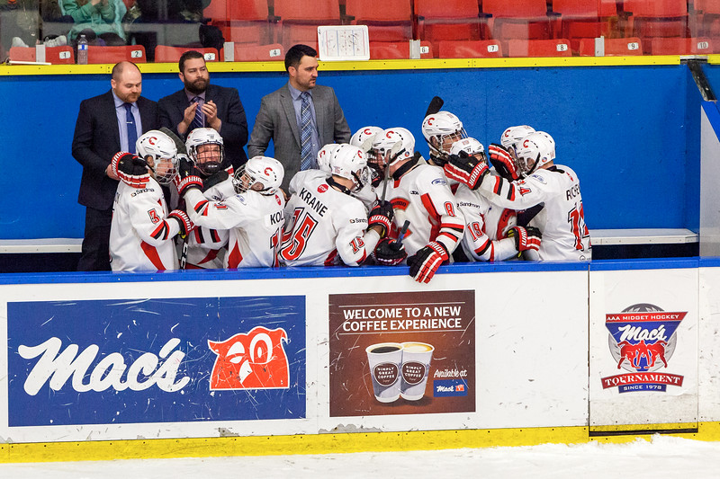 December 31, 2016 - Mac's Midget Tournament, Max Bell Centre, Calgary, Alberta - Male Division Semi-Final - Cariboo Cougars vs. Belarus National U17 - Cougars players bench celebrates #23 Hunter Floris's goal to tie the game.