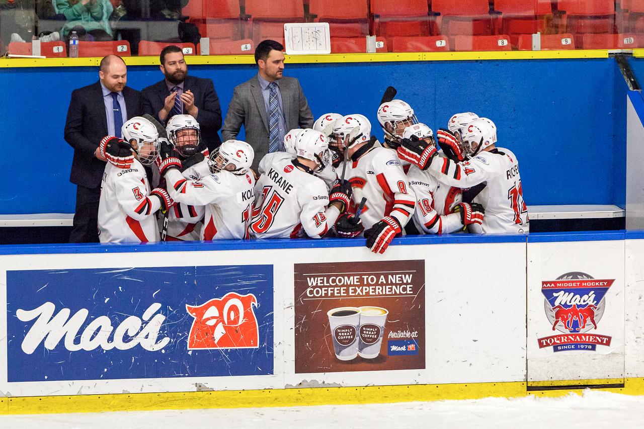 December 31, 2016 - Mac's Midget Tournament, Max Bell Centre, Calgary, Alberta - Male Division Semi-Final - Cariboo Cougars vs. Belarus National U17 - Cougars players bench celebrates #23 Hunter Floris's goal to tie the game.