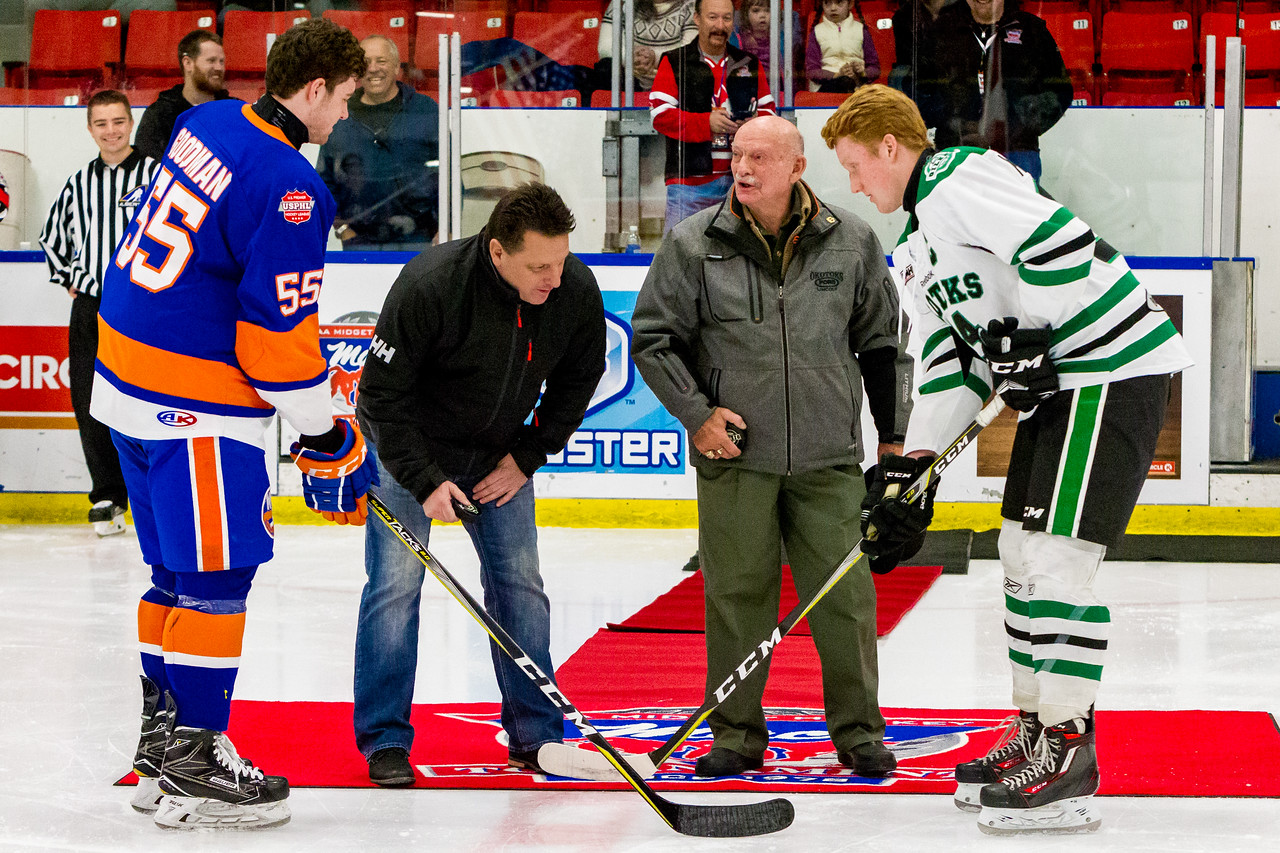 December 27, 2017 - Calgary, AB - 2017-2018 Mac's AAA Midget Hockey Tournament - Max Bell Centre Arenas. Jim 'Bearcat' Murray opens the game during the ceremonial faceoff between the Okotoks Oilers and the New York Jr. Islanders.