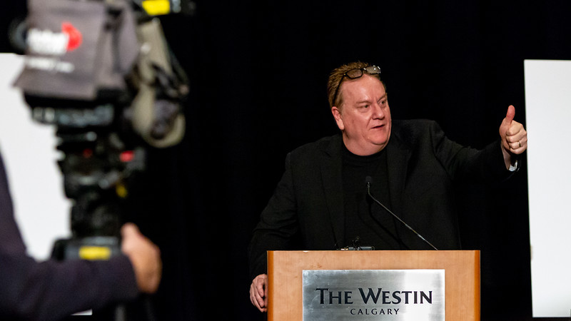 December 26, 2018 - Calgary, AB - Opening Press Conference at the Westin Hotel Calgary for the Mac's AAA Midget Hockey Tournament. Calgary and area teams revealed this years participating teams and pool placements. Jock Wilson salutes some of the long-serving Mac's Tournament organizations volunteers.