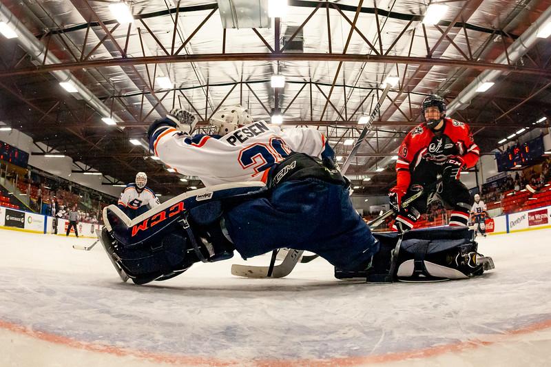 December 30, 2018 - Calgary, AB - Quarter Final / Game 51 - Saskatoon Blazers and the Airdrie CFR Bisons. Blazers goaltender gloves a shot.