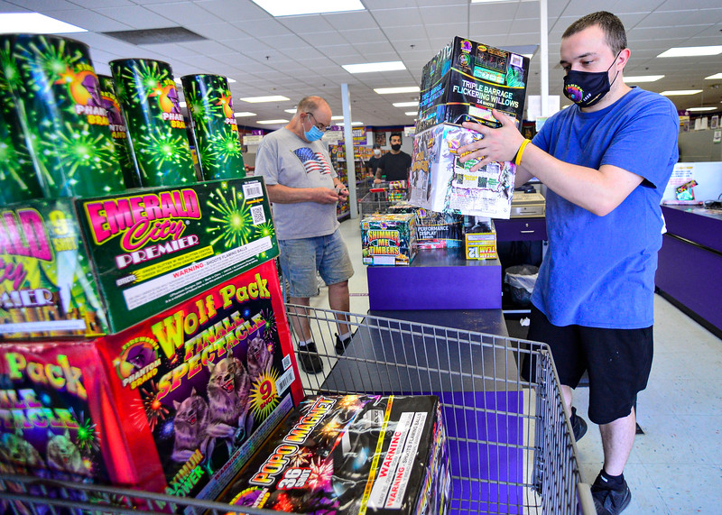 KRISTOPHER RADDER — BRATTLEBORO REFORMER<br /> James Pratt, head cashier at Phantom Fireworks, in Hinsdale, N.H., puts the fireworks back into a shopping cart after ringing out John Chandler, from Massachusetts, on Wednesday, June 24, 2020.