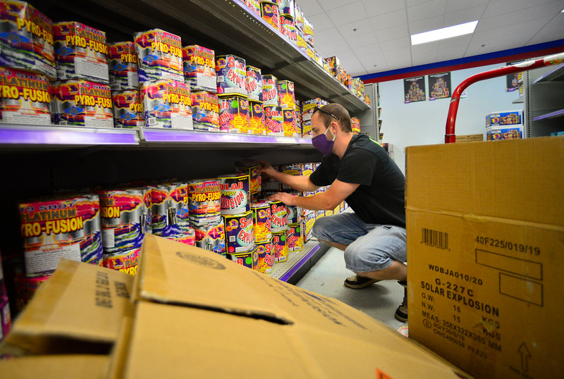 KRISTOPHER RADDER — BRATTLEBORO REFORMER<br /> Nicholas McTaggart, warehouse manager at Phantom Fireworks, in Hinsdale, N.H., restocks the shelves on Wednesday, June 24, 2020.