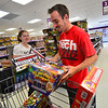 KRISTOPHER RADDER — BRATTLEBORO REFORMER<br /> Tim Richards and Jessica Mahoney, from New Hampshire, load up their cart with different fireworks displays at Phantom Fireworks, in Hinsdale, N.H., on Wednesday, June 24, 2020, to celebrate the Fourth of July.