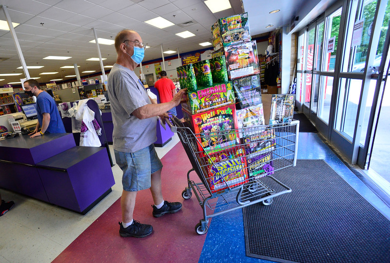KRISTOPHER RADDER — BRATTLEBORO REFORMER<br /> John Chandler, from Massachusetts, pushes his cart filled with fireworks after his purchase at Phantom Fireworks, in Hinsdale, N.H., on Wednesday, June 24, 2020.