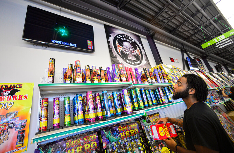 KRISTOPHER RADDER — BRATTLEBORO REFORMER<br /> Tredell Thompson, from Massachusetts, watches a display from a batch of fireworks he scanned in at Area 51 Fireworks, in Chesterfield, N.H., on Thursday, June 25, 2020.