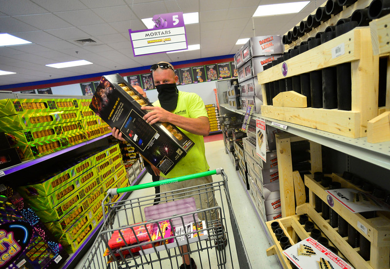 KRISTOPHER RADDER — BRATTLEBORO REFORMER<br /> Art Spielman, from Massachusetts, puts a case of motor shells into his cart while shopping at Phantom Fireworks, in Hinsdale, N.H., on Wednesday, June 24, 2020.