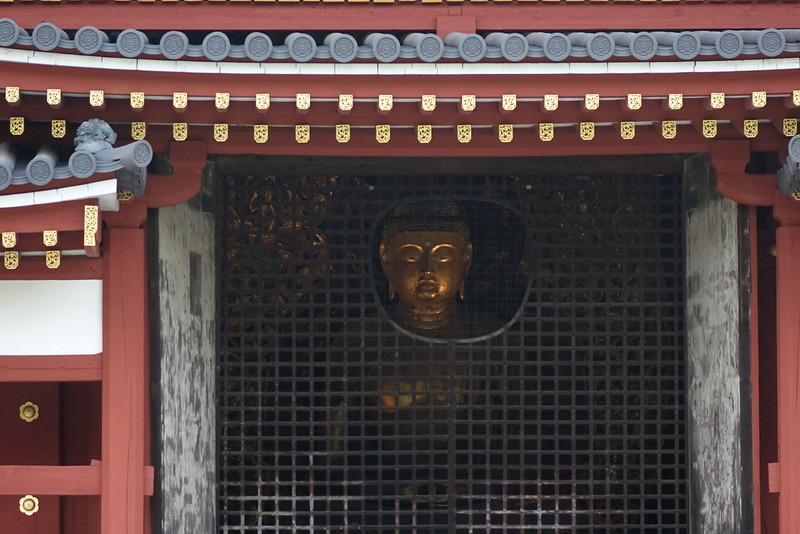 The Amida sculpture is made of Japanese cypress and is covered with gold leaf