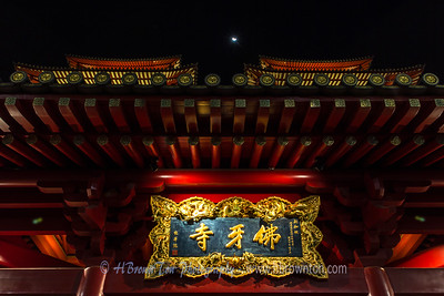 Tiny moon above Buddha Tooth Relic Temple