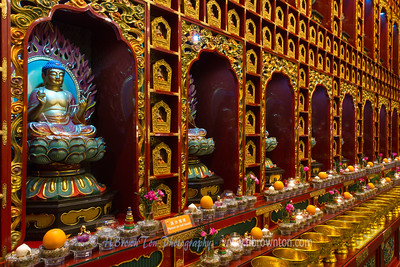 Rows of Buddhas and golden offering bowls -- Buddha Tooth Relic Temple