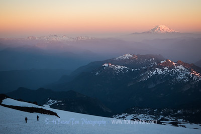 Two late climbers coming up from the Muir Snowfields; Mt. Adams in the Distance