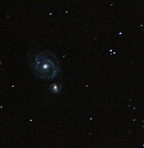 M51 Whirlpool Galaxy (crop, levels, color adjust).     100s at iso1600, single frame ugly tracking  first galaxy picture.   meh.
