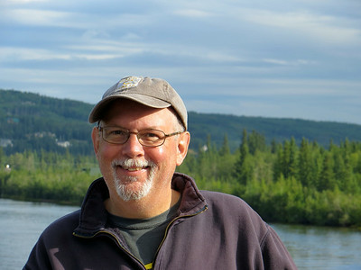Ed is smiling after a good nightís sleep and enjoying our leisurely cruise along the Chena River outside Fairbanks.
