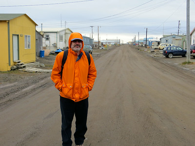 Main Street in Barrow, Alaska. No pavement, no sidewalks, no streetlights. No people out strolling around on a summer evening :)