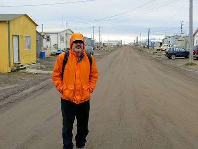 Main Street in Barrow, Alaska. No pavement, no sidewalks, no streetlights. No people out strolling around on a summer evening :)