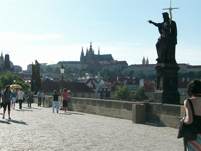 Statue of St. John the Baptist (1857) on the Charles Bridge (built in 1357); crosses the Vltava River and connects Old Town with Prague Castle.
