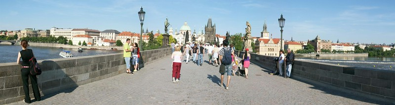 The Charles Bridge (built in 1357) in Prague crosses the Vltava River and connects Old Town with Prague Castle