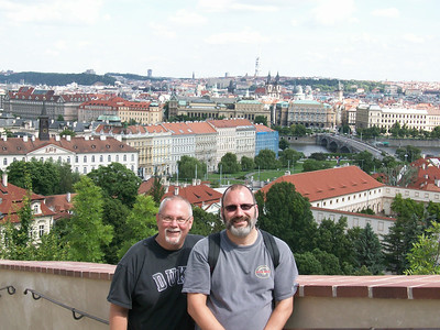 Ed and Joe at Prague Castle: Little Quarter Riverside is directly below us, the Charles Bridge and Vltava River can be seen in the center of the picture, and Old Town Prague is in the background.