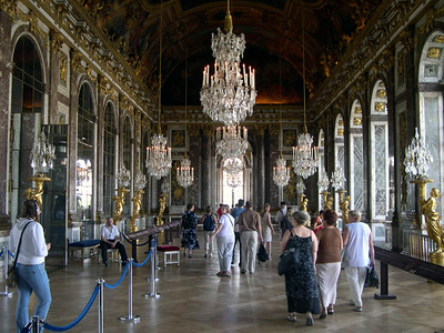 Inside the Palace of Versailles, in the Hall of Mirrors.