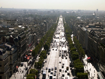 From the top of the Arc de Triomphe, looking east (into the sun) along the Champs-Elysees towards the Musee du Louvre.