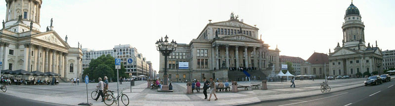 Panoramic view of Gendarmenmarkt with Franzosischer Dom (French Cathedral) on the left, Konzerhaus (Concert Hall) in the center, and Deutscher Dom (German Cathedral) on the right.