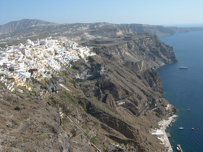 The main town of Thira on the island of Santorini. You can see the mule path leading up from the port in the foreground, and the port itself on the right side of the photo.