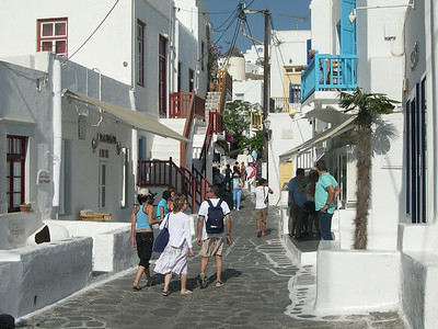 Mykonos Town is characterized by the traditional Cycladic architecture, primarily white and blue paint, and the crowded narrow streets filled with shops, galleries, restaurants and apartments.