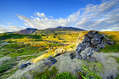 Snaefellsjoekull mountain and glacier across a lava field in Northwest Iceland.