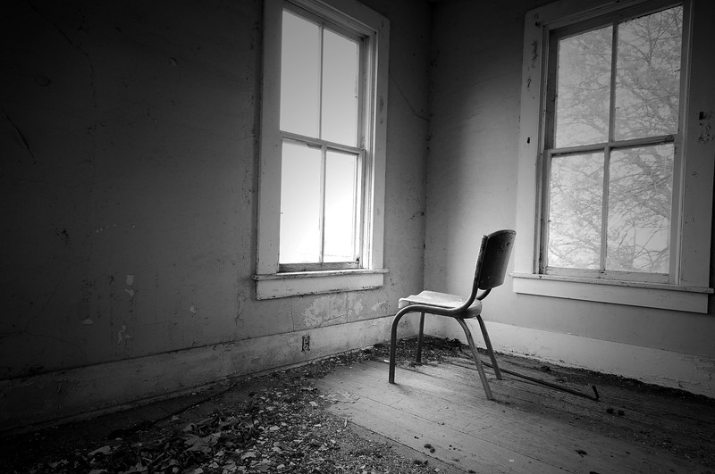 Lonely chair in an old Iowa farm house.