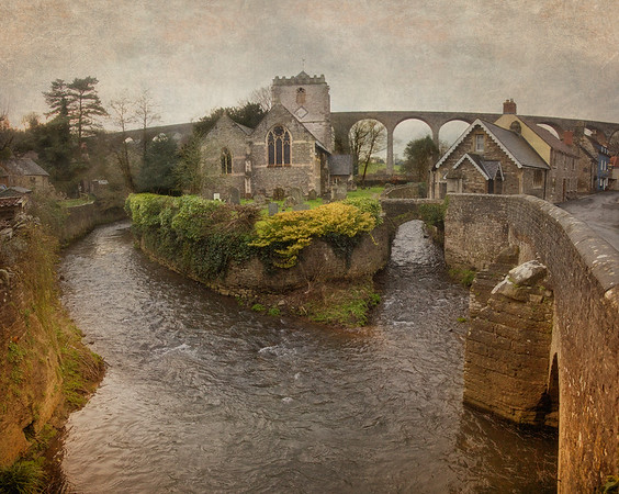 The Daily Ramble: The River Chew at Pensford  The village of Pensford is in Somerset, Great Britain.  A great flood of the River Chew in 1968 damaged the railroad viaduct in the background so extensively it never reopened. Also damaged was the St Thomas à Becket Church in the foreground, which was already in use in 1341.
