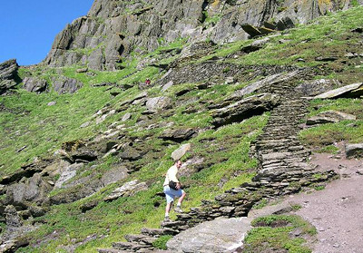 """Joe begins the steep climb to the summit of Skellig Michael â€"""" about 1000 steps, built by the monks that lived there from about 400 AD to 1300 AD."""