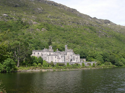 Kylemore Abbey, built as a country home in the late 19th century, sits on Kylemore Lough on the slopes of the Twelve Bens in northern Connemara National Park.