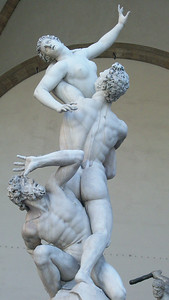 Giambologna's famous statue, Rape of the Sabine Women (1583), stands in Piazza della Signoria outside the Uffizi in Florence.