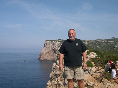 Ed at the edge of the cliff on the oceanside of Capo Caccia. There's a stiff wind blowing and moving from rock to rock along the cliff's edge (no path) is a bit tricky.