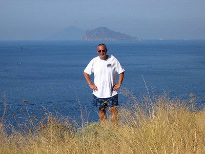 Ed on one of our afternoon drives around the island -- that's  Isola Panarea and Isola Stromboli in the background.