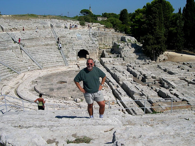 Ed, standing among the ruins of the Greek Amphitheatre in Siracusa.