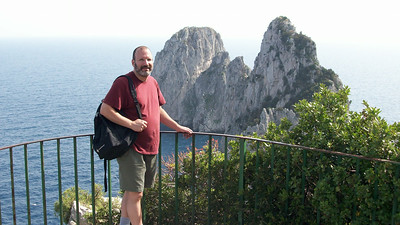 Joe, at the beginning of our 500-mile hike along the southern coast of Capri (the famous Faraglioni rocks are in the background).