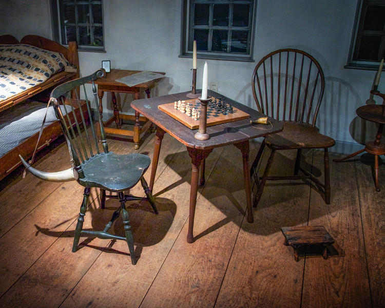 Colonial Era Architecture: Bedroom Furniture and Checker Board in the Museum at the Wayside Inn, c. 1716, Sudbury, Middlesex County, Massachusetts
