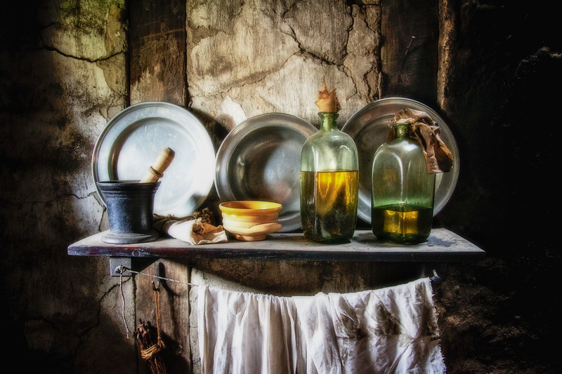 Life in Plymouth Colony: Plates, Oil, Mortar and Pestal on a Shelf, 1627 English Village, Plimoth Plantation, Plymouth, Massachusetts