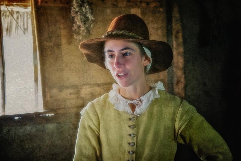 Life in Plymouth Colony: Costumed Female Pilgrim Interpreter, 1627 English Village, Plimoth Plantation, Plymouth, Massachusetts
