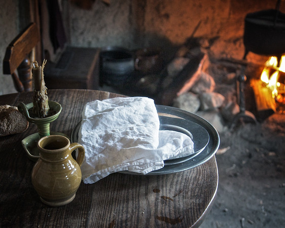 Life in Plymouth Colony: Wooden Table With Mug, Candle and Plates, 1627 English Village, Plimoth Plantation, Plymouth, Massachusetts