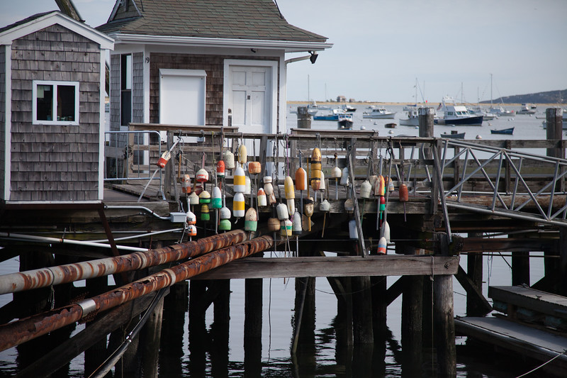 Fishing floats and boats and Plymouth Harbor, Plymouth, Massachusetts