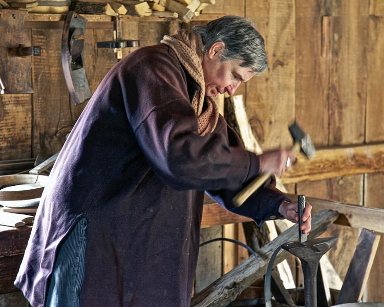 Nineteenth Century Daily Life:  Male Interpreter Working In Interior of Cooper Shop. Freeman Farm, c. 1840. Old Sturbridge Village, Worcester County, Massachusetts